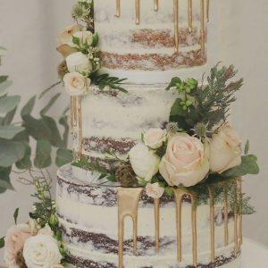 semi naked wedding cake with drip