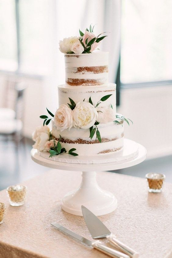 Classic semi naked wedding cake with florals