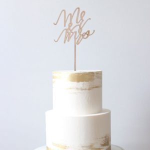 White and Gold speck wedding cake bali