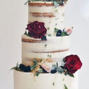 Semi Naked classic wedding cake with florals